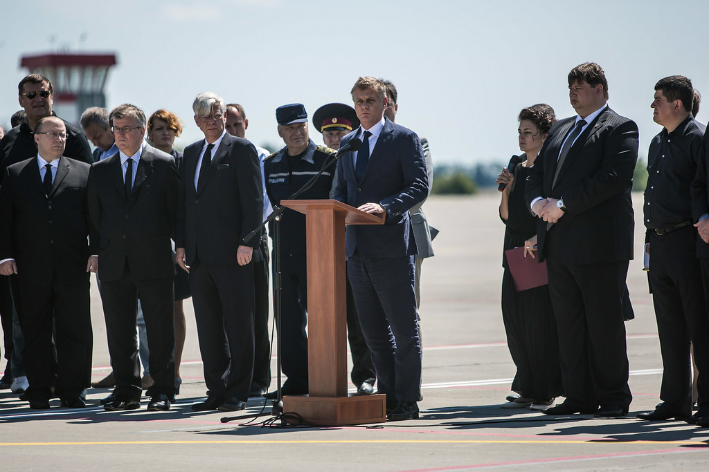. Hans Docter (C), Dutch Ambassador to Ukraine, speaks at a departure ceremony for the victims of the crash of Malaysia Airlines flight MH17 to the Netherlands during a departure ceremony on July 23, 2014 in Kharkiv, Ukraine. Malaysia Airlines flight MH17 was traveling from Amsterdam to Kuala Lumpur when it crashed killing all 298 on board including 80 children. The aircraft was allegedly shot down by a missile and investigations continue over the perpetrators of the attack. (Photo by Brendan Hoffman/Getty Images)