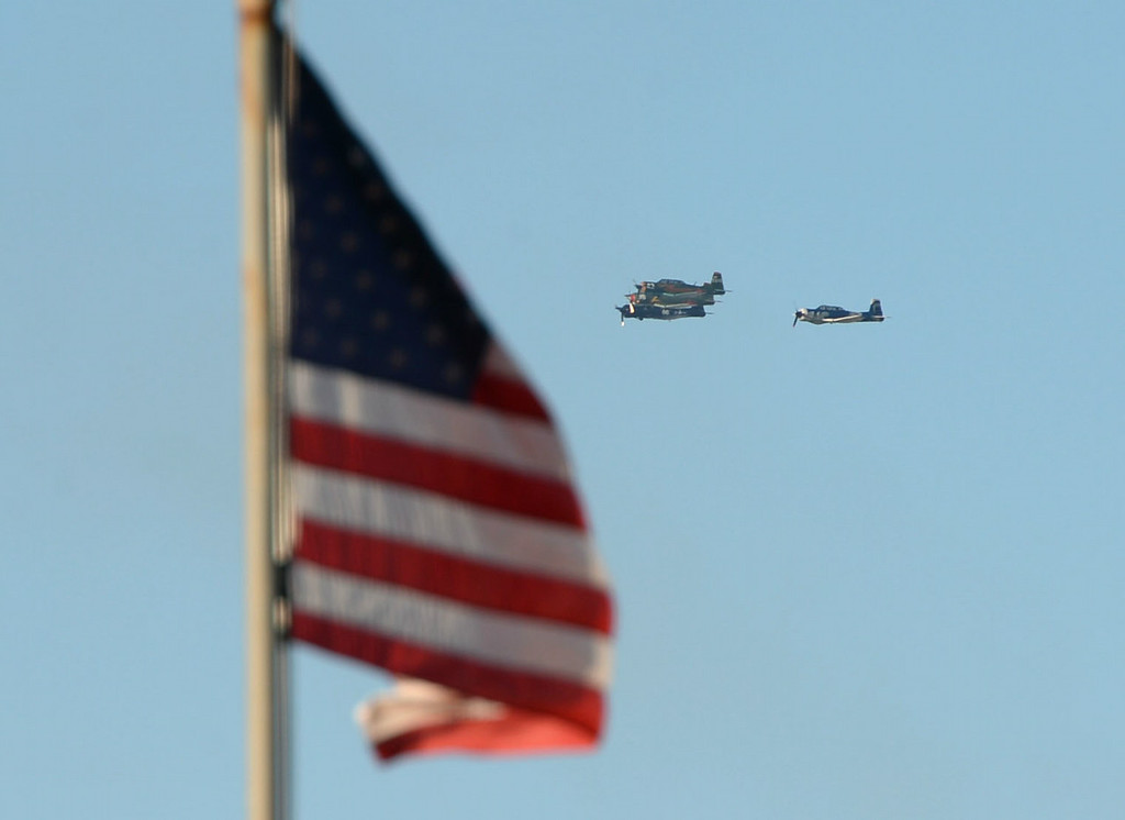 . The Tiger Squadron does a fly-over for a memorial for Torrance legend Louis Zamperini who died earlier this month Thursday, July 31, 2014, Torrance, CA.  Zamperini was an Olympian, WWII bomber pilot and Japanese POW. A book by Laura Hildebrand titled Unbroken documented his life and a movie directed by Angelina Jolie will be released in December. Photo by Steve McCrank/Daily Breeze