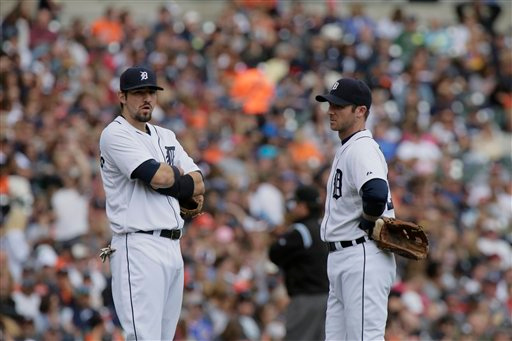 . Detroit Tigers\' Nick Castellanos and Andrew Romine talks while a replacement pitcher warms up during the sixth inning of a baseball game against the Cleveland Indians Sunday, Sept. 14, 2014, in Detroit. (AP Photo/Duane Burleson)