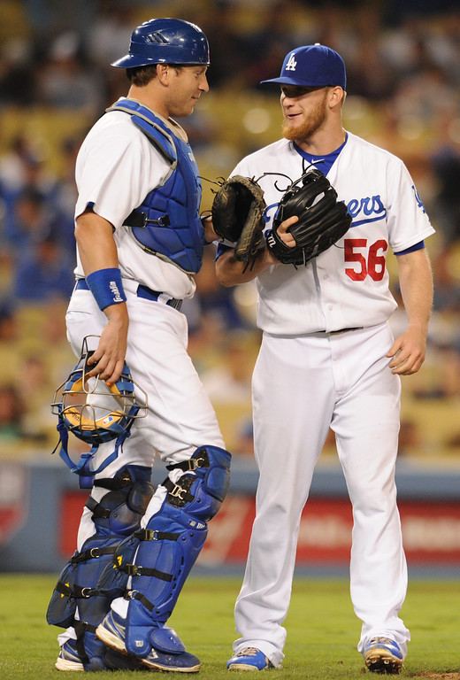 . Dodgers A.J. Ellis and J.P. Howell have a short conversation in the 10th inning. The Dodgers defeated the Arizona Diamondbacks 5-3 after Scott Van Slyke hit a 2 run walk off homer in the 11 inning at Dodger Stadium in Los Angeles, CA. 9/10/2013. photo by (John McCoy/Los Angeles Daily News)