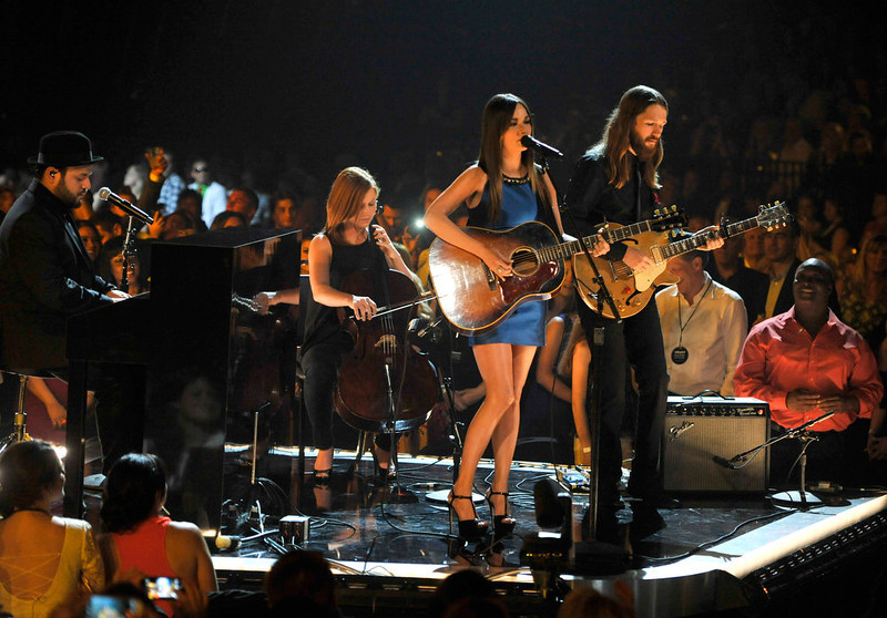 . Kacey Musgraves, center, performs at the Billboard Music Awards at the MGM Grand Garden Arena on Sunday, May 19, 2013 in Las Vegas. (Photo by Chris Pizzello/Invision/AP)