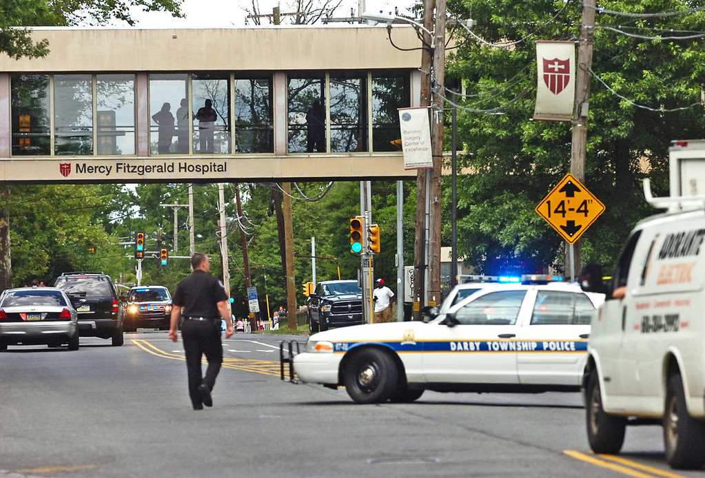 . Police  direct traffic on Lansdowne Avenue after a shooting in the Sister Marie Lenahan Wellness Center in Yeadon on the campus of Mercy Fitzgerald Hospital Thursday. (Times Staff / JULIA WILKINSON )