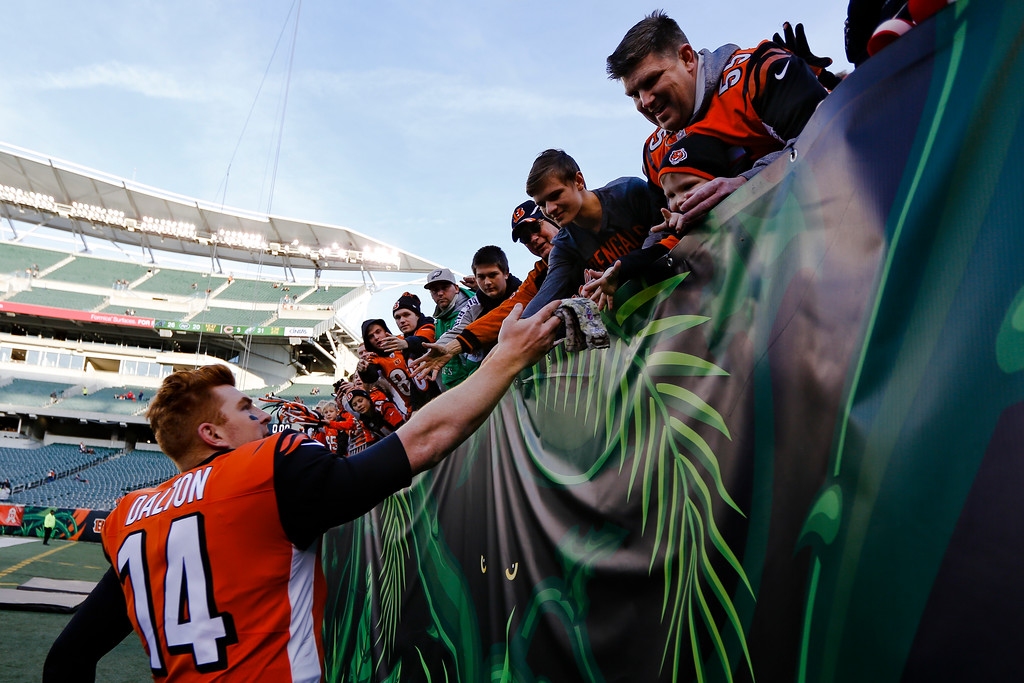 . Cincinnati Bengals quarterback Andy Dalton (14) greets fans after an NFL football game against the Cleveland Browns, Sunday, Nov. 26, 2017, in Cincinnati. (AP Photo/Frank Victores)
