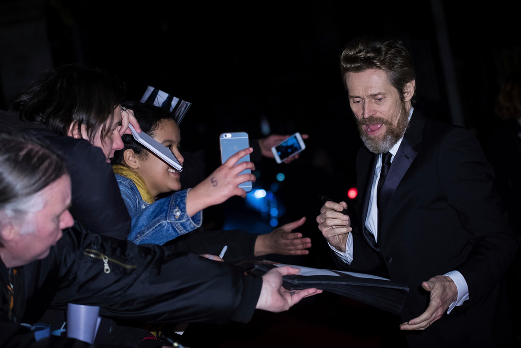 . Willem Dafoe signs autographs upon arrival at the BAFTA Film Awards after-party, in London, Sunday, Feb. 18, 2018. (Photo by Vianney Le Caer/Invision/AP)