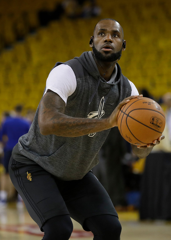 . Cleveland Cavaliers forward LeBron James warms up before Game 2 of basketball\'s NBA Finals against the Golden State Warriors in Oakland, Calif., Sunday, June 4, 2017. (AP Photo/Marcio Jose Sanchez)