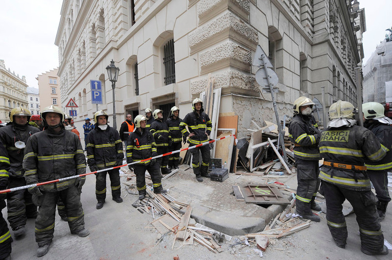 . Firemen work at the scene of a strong blast in a building in the centre of Prague, Czech Republic, Monday, April 29, 2013. After the explosion, probably caused by gas leak, there are some 40 injuries, mostly light. The blast broke windows in a broad vicinity, a number of people have been cut by the glass. Rescuers are still looking for possible people under the debris. (AP Photo/CTK, Stanislav Zbynek)