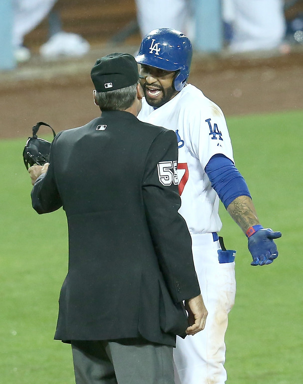 . LOS ANGELES, CA - APRIL 25:  Matt Kemp #27 of the Los Angeles Dodgers argues with home plate umpire Angel Hernandez after being called out on strikes in the ninth inning against the Colorado Rockies at Dodger Stadium on April 25, 2014 in Los Angeles, California. Hernandez ejected Kemp during the exchange.  (Photo by Stephen Dunn/Getty Images)
