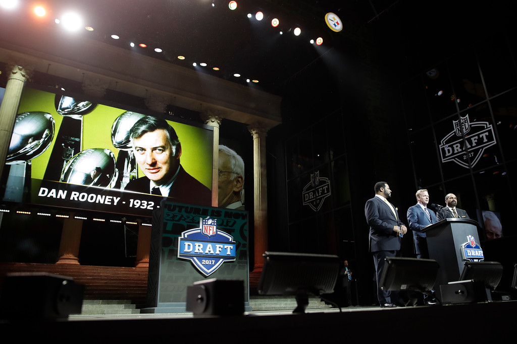 . NFL commissioner Roger Goodell, center, and former Pittsburgh Steelers\' Jerome Bettis, left, and Franco Harris pay tribute to Dan Rooney during the first round of the 2017 NFL football draft, Thursday, April 27, 2017, in Philadelphia. (AP Photo/Matt Rourke)