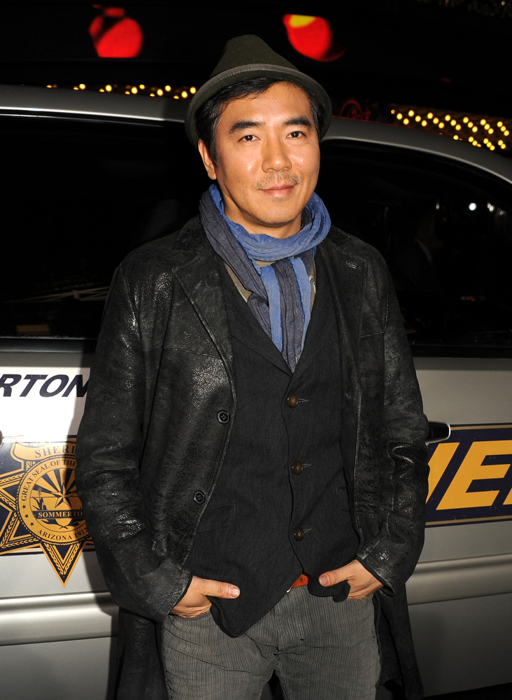 ". Director Jee-woon Kim arrives at the premiere of Lionsgate Films\' ""The Last Stand\"" at Grauman\'s Chinese Theatre on January 14, 2013 in Hollywood, California.  (Photo by Kevin Winter/Getty Images)"