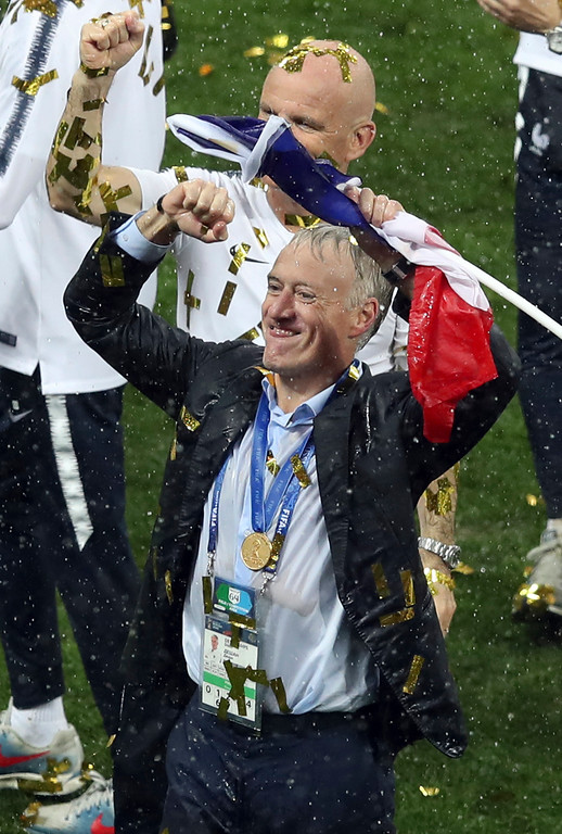 . France head coach Didier Deschamps celebrates at the end of the final match between France and Croatia at the 2018 soccer World Cup in the Luzhniki Stadium in Moscow, Russia, Sunday, July 15, 2018. (AP Photo/Thanassis Stavrakis)