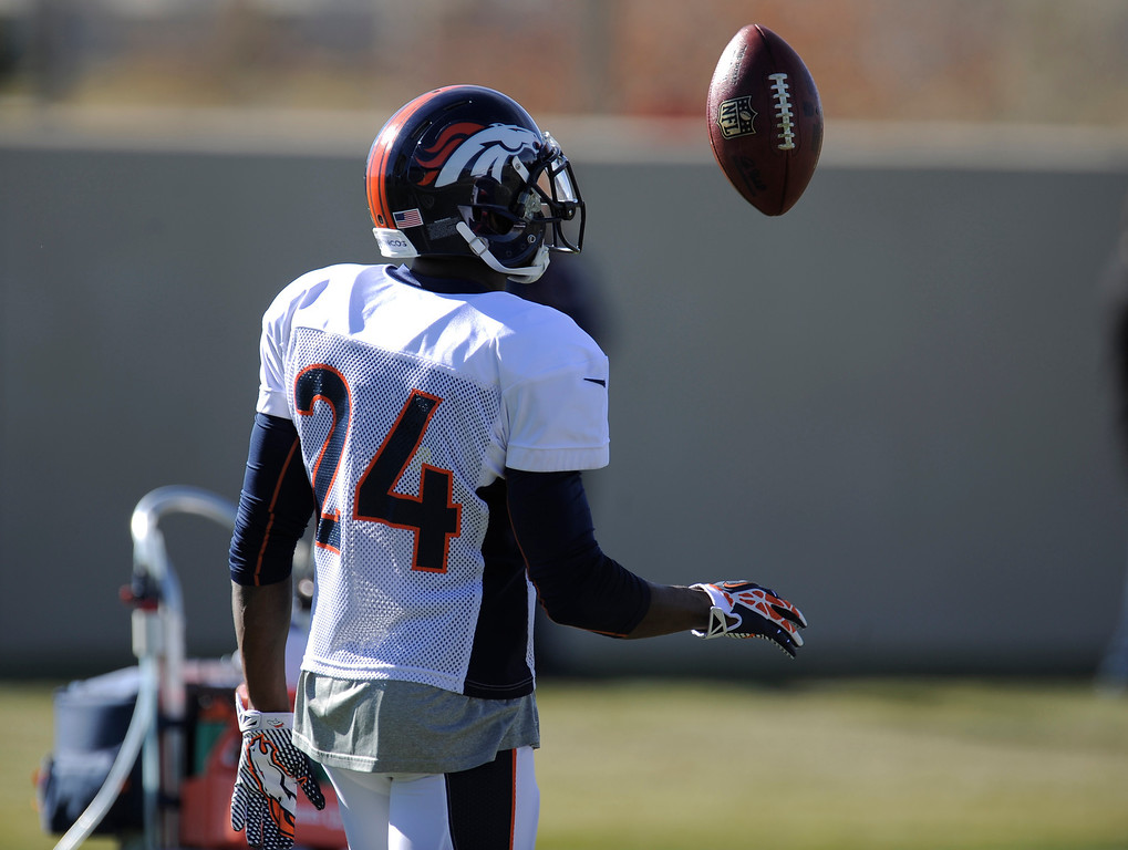 . Denver Broncos cornerback Champ Bailey (24) flips the football in the air during practice November 13, 2013 at Dove Valley (Photo by John Leyba/The Denver Post)
