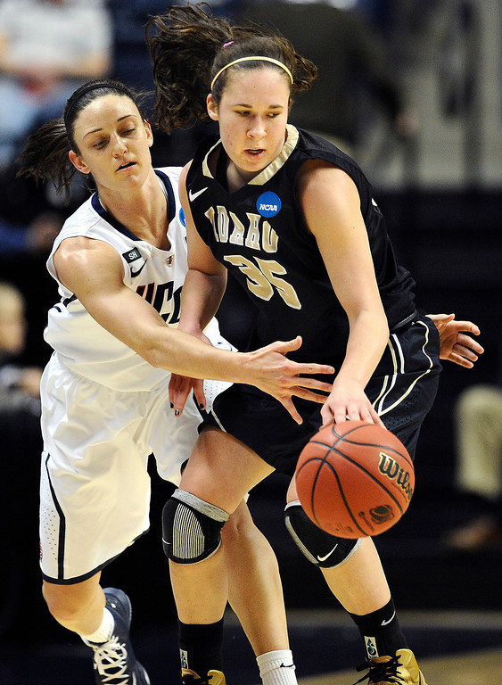 . Connecticut\'s Kelly Faris, left, pressures Idaho\'s Connie Ballestero, right, in the first half of a first-round game in the women\'s NCAA college basketball tournament in Storrs, Conn., Saturday, March 23, 2013. (AP Photo/Jessica Hill)