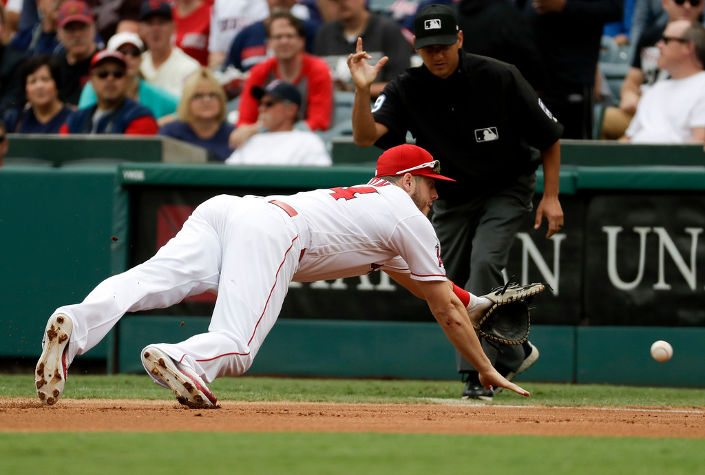 . Los Angeles Angels first baseman C.J. Cron fields a ball hit by Cleveland Indians\' Carlos Santana during the first inning of a baseball game in Anaheim, Calif., Thursday, Sept. 21, 2017. Santana was out at first. (AP Photo/Chris Carlson)