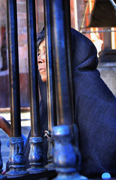 woman behind gate.jpg