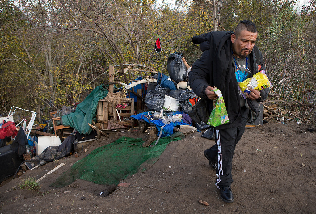 . Valentin Cortez-Oseguer leaves the homeless encampment known as The Jungle before construction crews clear the campsite he shared with An Phuc Nguyen at The Jungle in San Jose, Calif., on Thursday, Dec. 4, 2014. Cortez-Oseguer said he\'s leaving with the same possessions he arrived with.  (LiPo Ching/Bay Area News Group)