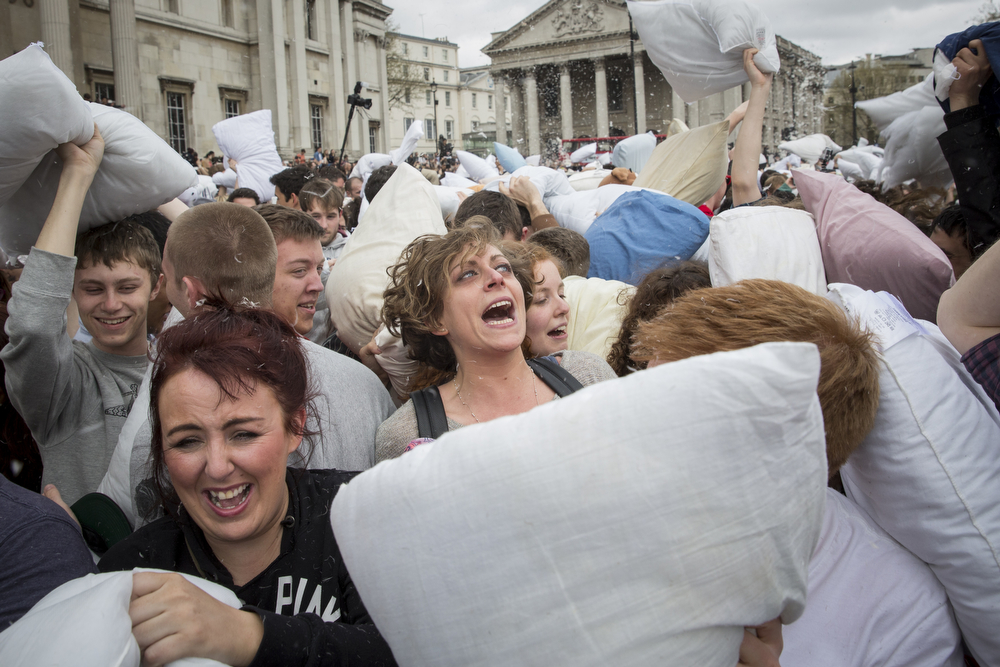 Description of . Revelers take part in a giant pillow fight on the north terrace of Trafalgar Square on 'International Pillow Fight Day' on April 5, 2014 in London, England.  Pillow fights have been organized in numerous other cities around the world simultaneously.  (Photo by Rob Stothard/Getty Images)