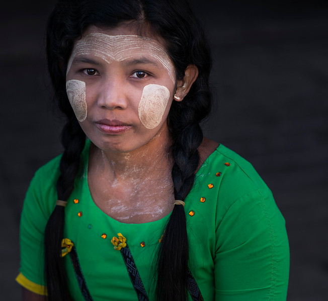 Portrait of a young woman wearing traditional thanaka on her face.  Myanmar 2017