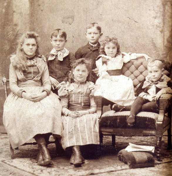 I don't know exactly who is who but I think my grandfather Julian Sale (1883 - 1927) is on the far right.  His siblings from left to right were (using estimated age as primary identifier): Norah (1875-1967), Gordon (1982-1926), May (1877-1964), Burton (1877-1957), Marion (1886-1948)