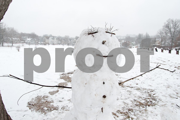 01/17/18 Wesley Bunnell   Staff A snowman with arms outstretched stands in Walnut Hill Park on Wednesday after a new winter storm spread several inches of snow starting early Wednesday morning.