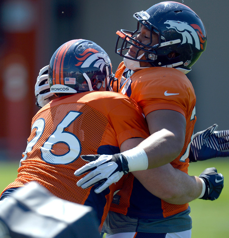 . Denver Broncos DT Mitch Unrein (96) and DT Romney Fuga (76) runs through drills during training camp July 31, 2013 at Dove Valley. (Photo By John Leyba/The Denver Post)