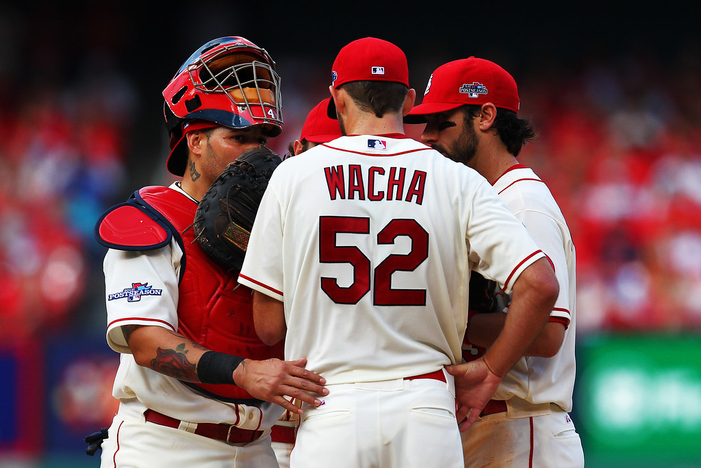 . ST LOUIS, MO - OCTOBER 12:  Michael Wacha #52 talks to Yadier Molina #4 and Matt Carpenter #13 of the St. Louis Cardinals on the mound in the sixth inning against the Los Angeles Dodgers during Game Two of the National League Championship Series at Busch Stadium on October 12, 2013 in St Louis, Missouri.  (Photo by Dilip Vishwanat/Getty Images)