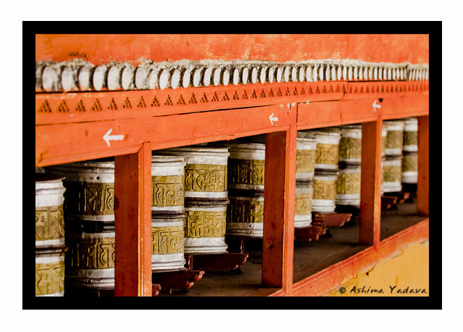 Prayer wheel or Mani wheel (mani chos-'khor - 'Mani' - a contraction of sanskrit for chintamani, 'chos' sanskrit for dharma and 'khor' sanskrit for chakra).)<br /> <br /> Hemis Monastery, Ladakh.