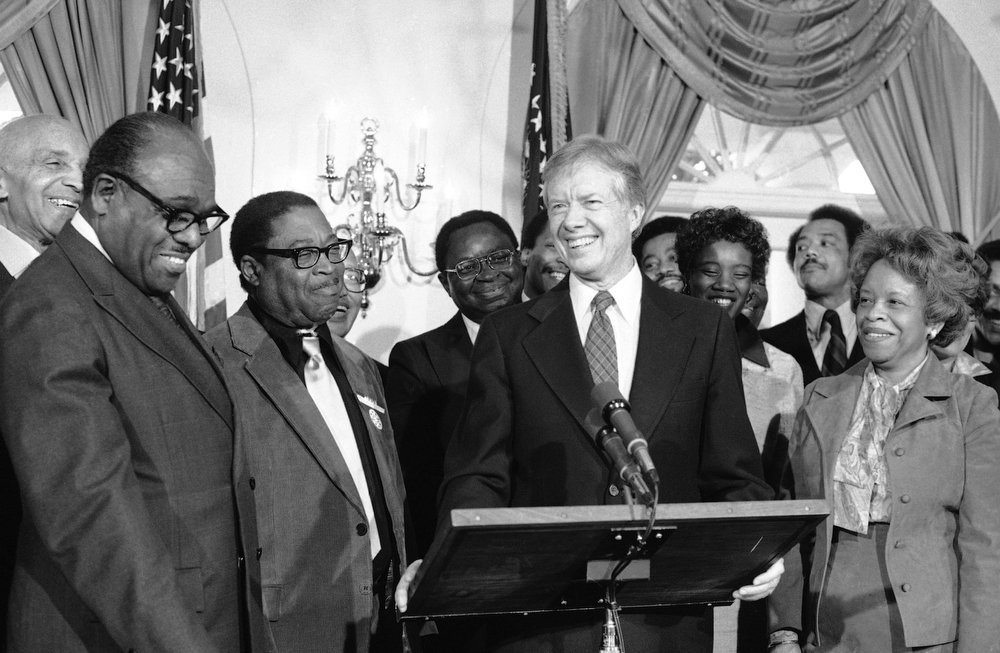". President Jimmy Carter draws smiles from black leaders in the Cabinet Room of the White House in Washington, Jan. 15, 1980, as he declares February ""Black History Month\"". (AP Photo/Harvey Georges)"