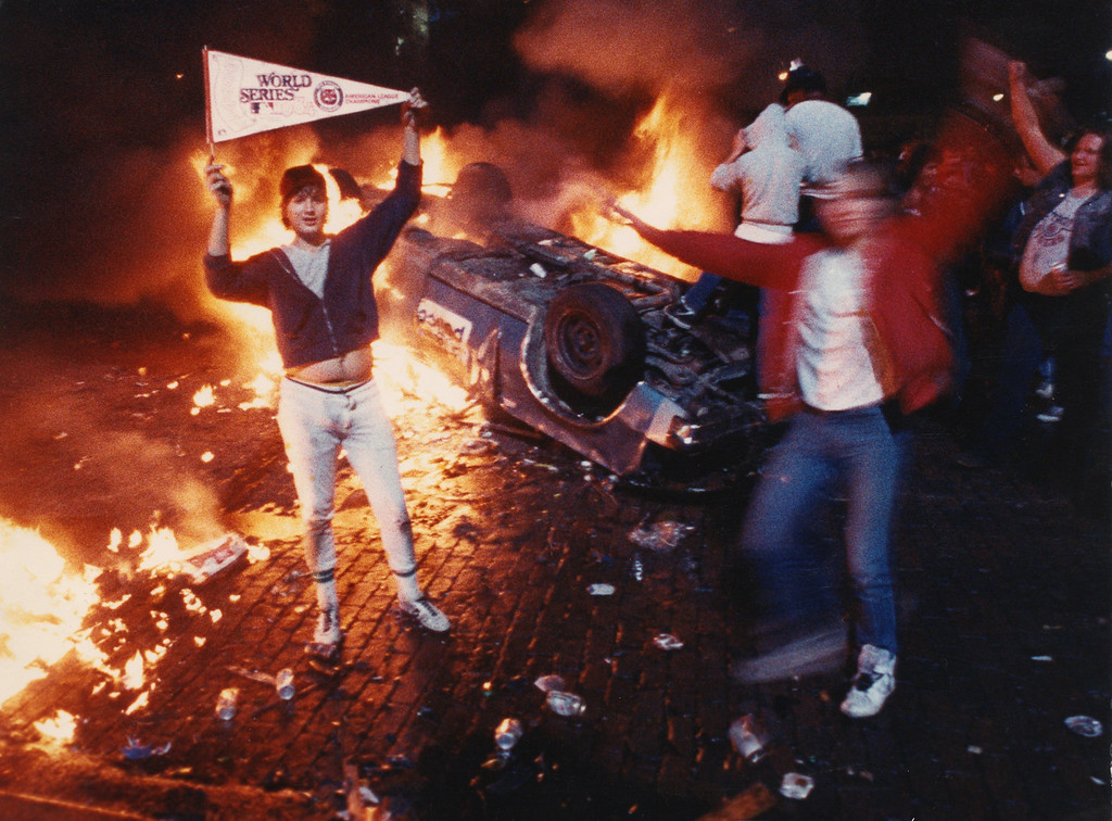 . ** FILE** Bubba Helms, left, celebrates after the Detroit Tigers won the 1984 World Series in Detroit in 1984. Detroit erupted into chaos in 1984, following the Tigers\' World Series victory over the San Diego Padres.  (AP Photo/Robert Kozloff)
