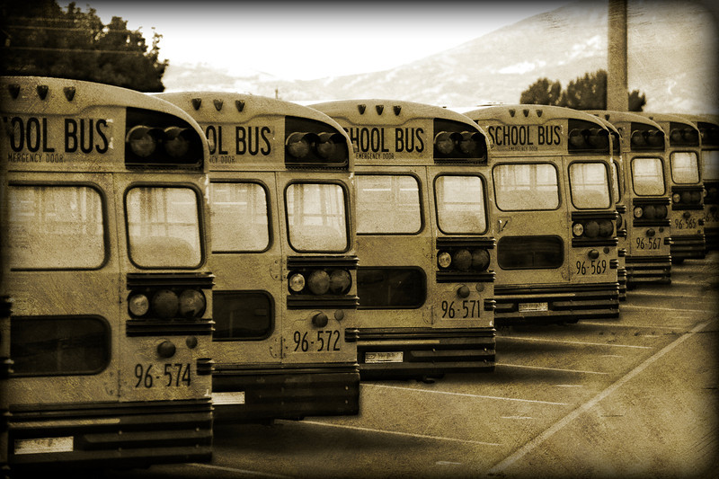 2011/8/1 – School will be starting shortly but for now all the school buses are parked at the bus depot. I shot this through the fence and then applied a variety of special effects in Photoshop to make it a little more interesting than just a bunch of yellow buses. The main filter is one called, Dirty Money. I like the final product.