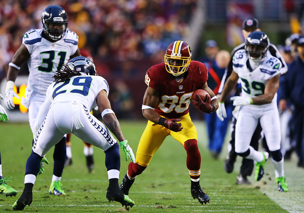 Description of . Earl Thomas #29 of the Seattle Seahawks looks to tackle Pierre Garcon #88 of the Washington Redskins in the first quarter of the NFC Wild Card Playoff Game at FedExField on January 6, 2013 in Landover, Maryland.  (Photo by Al Bello/Getty Images)