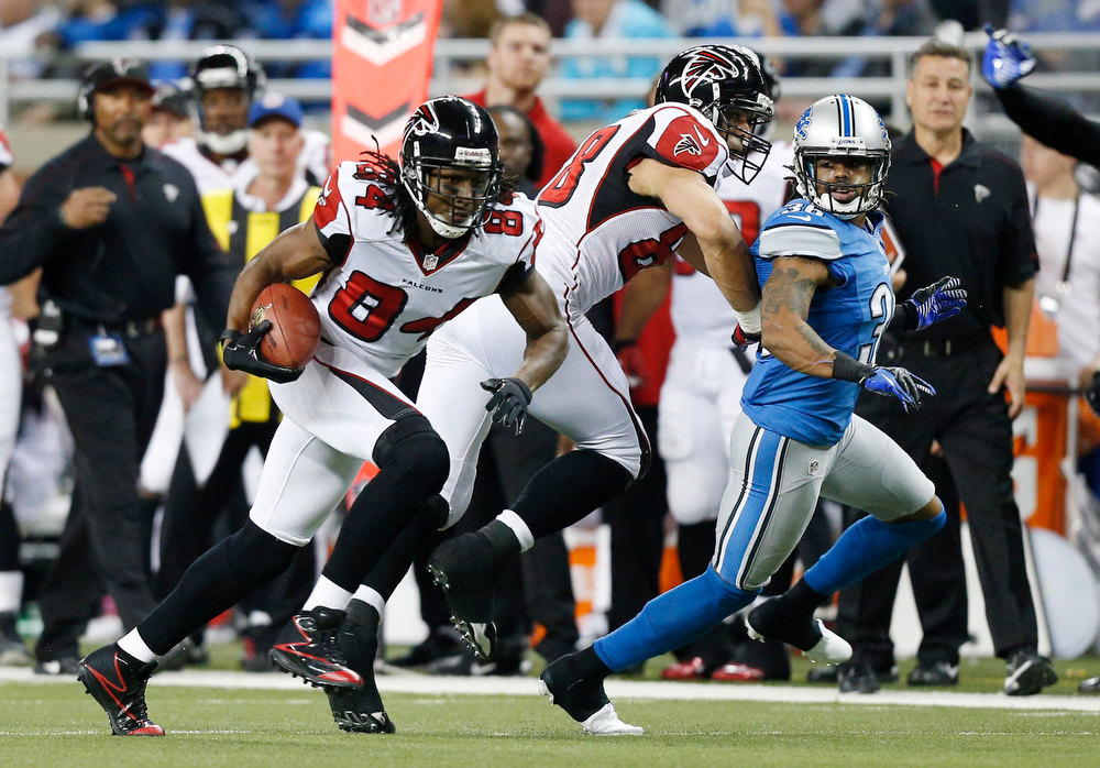 Description of . Atlanta Falcons wide receiver Roddy White (84) breaks away from the Detroit Lions defense for a 39-yard touchdown during the second quarter of an NFL football game at Ford Field in Detroit, Saturday, Dec. 22, 2012. (AP Photo/Rick Osentoski)