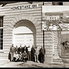 "A group of Homestake Gold Mining officials assembled in front of Hydroelectric Plant No. 1 in Spearfish on April 11, 1952 for this photograph.  Assembled were (kneeling):  G.R. Harris, N.G. Jerde, C.L. Gust; (standing): Bennie Carlson, Emil Hermanson, Robert Parker, George Gibson, Fred Langhoff, Ole Swanson, Rex Tario, and U. E. Danielson.  Inset is a photo of the plant under construction in 1911.  By 1952 th plant ""generates 33,000 volts, carrying electricity to the Spearfish Sawmill and to the Kirk Power Plan near Lead for distribution to other operations.""   Thanks to the City of Spearfish Power Plant staff for sharing this photo."