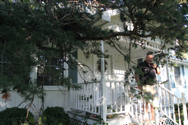 Good ole Charlie ......... still smiling even as that tree is hanging off his ROOF!