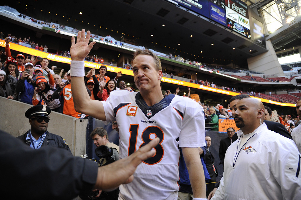 . HOUSTON, TX. - December 22: Quarterback Peyton Manning #18 of the Denver Broncos waving to the fans after winning against the Houston Texans at Reliant Stadium December 22, 2013 Houston, Texas. (Photo By Joe Amon/The Denver Post)