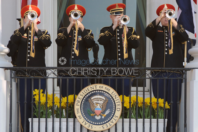Trumpeters blare during an Official State Arrival Ceremony.