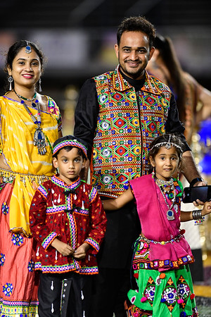 9/14/2019 Mike Orazzi | Staff Members of the Badgujar family, Jigisha and her husband Jigar and their children Aarambh and Shree, during the Indian festival Navaratri held at Veterans Memorial Stadium in New Britain on Saturday night.