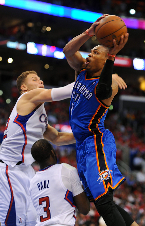. The Thunder\'s drives the key against Blake Griffin and Chris Paul. (Photo by Michael Owen Baker/Los Angeles Daily News)
