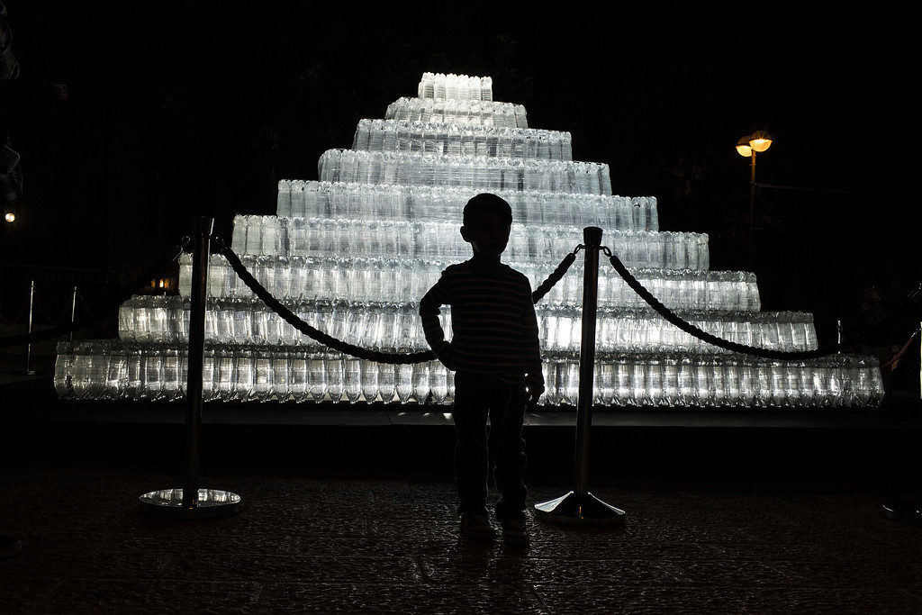 . JERUSALEM, ISRAEL - JUNE 5: A visitor poses for a picture next to a light installation during the annual Jerusalem Festival of Light on June 5, 2013 in Jerusalem, Israel. During the festival light installations are projected onto the historic buildings of Jerusalem\'s Old City.  (Photo by Ilia Yefimovich/Getty Images)