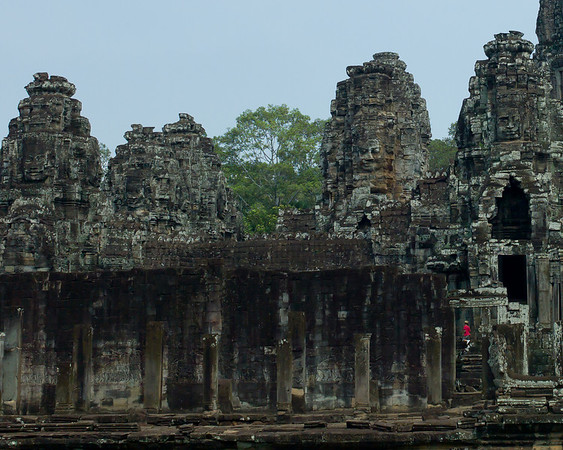 """Angkor Thom (literally: """"Great City"""") was the last and most enduring capital city of the Khmer empire. It was established in the late twelfth century by king Jayavarman VII. It covers an area of 9 km², within which are located several monuments from earlier eras as well as those established by Jayavarman and his successors. At the centre of the city is Jayavarman's state temple, the Bayon, with the other major sites clustered around the Victory Square immediately to the north.  http://www.angkorguides.com/?cat=345"""