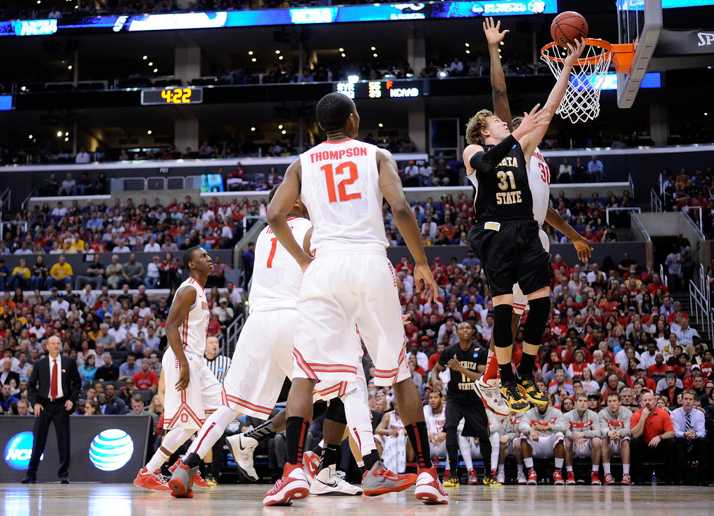 . LOS ANGELES, CA - MARCH 30:  Ron Baker #31 of the Wichita State Shockers goes up for a shot against Evan Ravenel #30 of the Ohio State Buckeyes in the first half during the West Regional Final of the 2013 NCAA Men\'s Basketball Tournament at Staples Center on March 30, 2013 in Los Angeles, California.  (Photo by Harry How/Getty Images)
