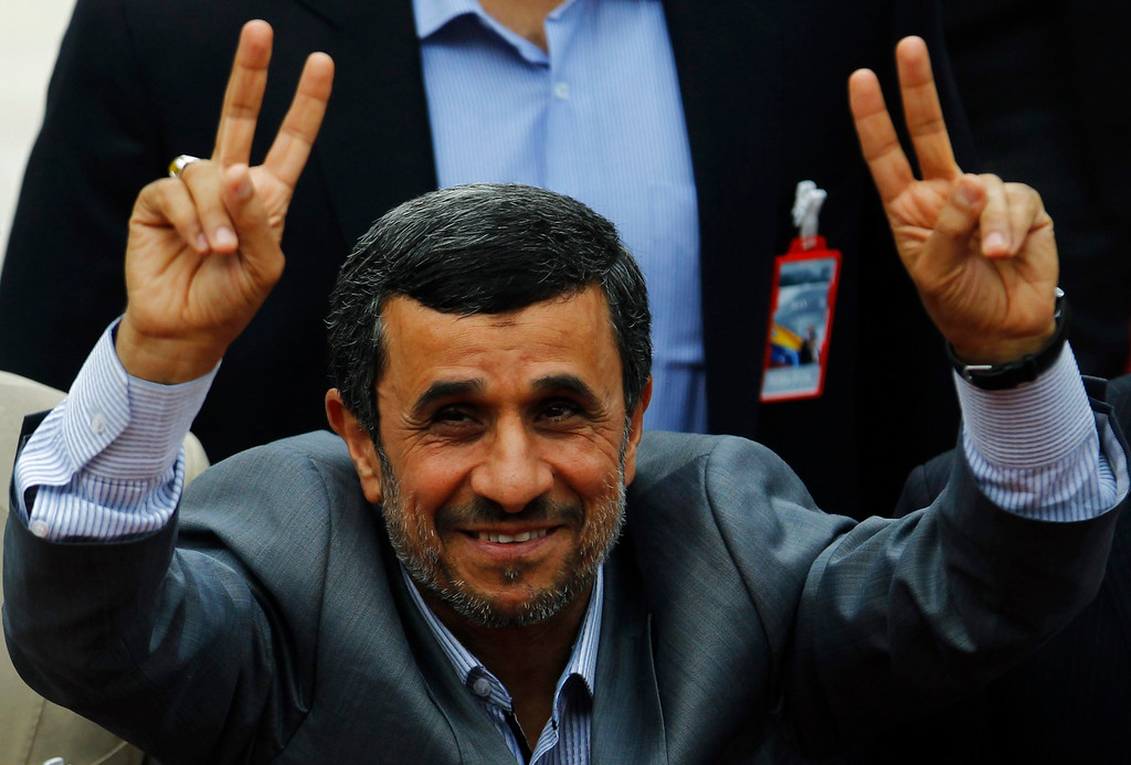 . Iran\'s President Mahmoud Ahmadinejad gestures to supporters during a ceremony to swear Venezuela\'s President Nicolas Maduro (not pictured) into office, in Caracas April 19, 2013. Maduro was sworn in as Venezuela\'s president on Friday at a ceremony attended by several countries\' leaders, after a decision to widen an electronic audit of the vote took some of the heat out of a dispute over his election. REUTERS/Carlos Garcia Rawlins
