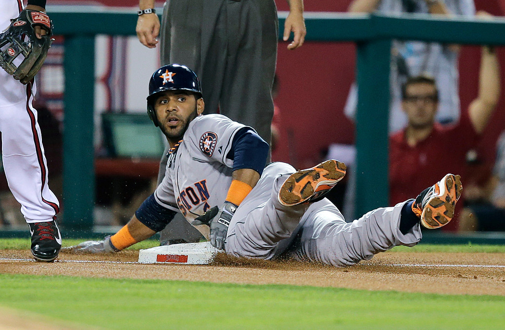. Houston Astros\' Jonathan Villar takes third base on a throwing error by Los Angeles Angels starting pitcher Jerome Williams during the third inning of a baseball game Friday, Aug. 16, 2013, in Anaheim, Calif. (AP Photo/Jae C. Hong)