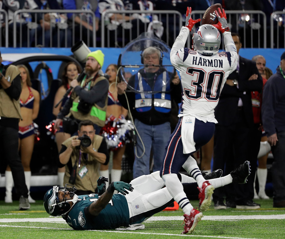 . New England Patriots strong safety Duron Harmon (30) grabs a ball for an interception after Philadelphia Eagles wide receiver Alshon Jeffery (17), misses a catch during the first half of the NFL Super Bowl 52 football game Sunday, Feb. 4, 2018, in Minneapolis. (AP Photo/Chris O\'Meara)