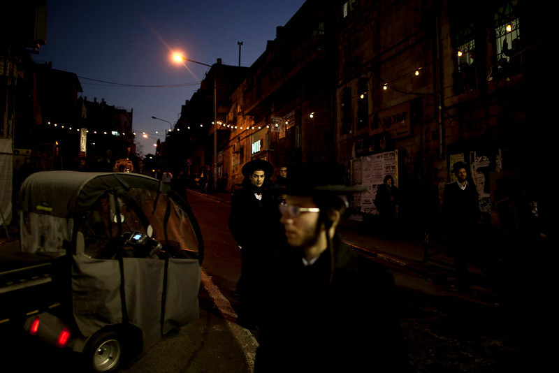 . Ultra Orthodox Jews belonging to the Satmar Hasidic group headed by Satmar  Admor of Williamsburg, Rabbi Zalman Leib Teitelbaum, gather for an anti-election rally ahed of the upcoming election, the Ultra Orthodox Jewish neighborhood of Mea Shearim in Jerusalem, Sunday, Jan. 20, 2013. General elections in Israel are scheduled for Jan. 22, 2013. (AP Photo/Oded Balilty)