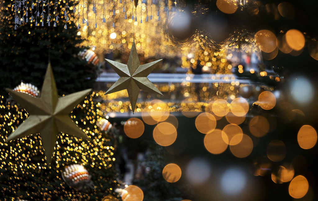 . Christmas trees and decorations can be seen at a shopping mall on Christmas Eve on December 24, 2013 in Berlin.  DAVID GANNON/AFP/Getty Images