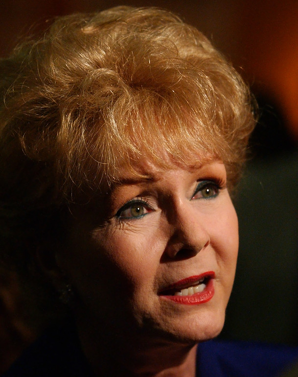 """. Actress Debbie Reynolds, who starred in \""""Singin\' in the Rain,\"""" is interviewed at a 50th anniversary screening of the film in Beverly Hills, Calif., Thursday, Sept. 5, 2002. (AP Photo/Lucy Nicholson)"""