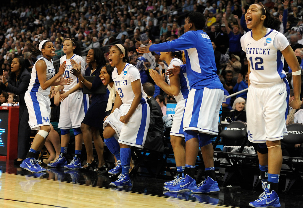. The Kentucky bench, including Azia Bishop (50), Janee Thompson (3) and Jelleah Sidney (12), celebrates during the final seconds of a regional semifinal against Delaware in the NCAA college basketball tournament in Bridgeport, Conn., Saturday, March 30, 2013. Kentucky won 69-62. (AP Photo/Jessica Hill)