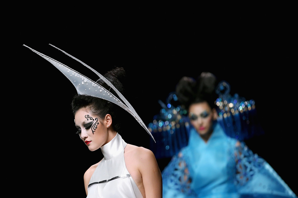 . Two models showcase designs on the runway at MGPIN 2015 Mao Geping Makeup Trends Launch show during Mercedes-Benz China Fashion Week Spring/Summer 2015 at Beijing Hotel on October 27, 2014 in Beijing, China.  (Photo by Feng Li/Getty Images)