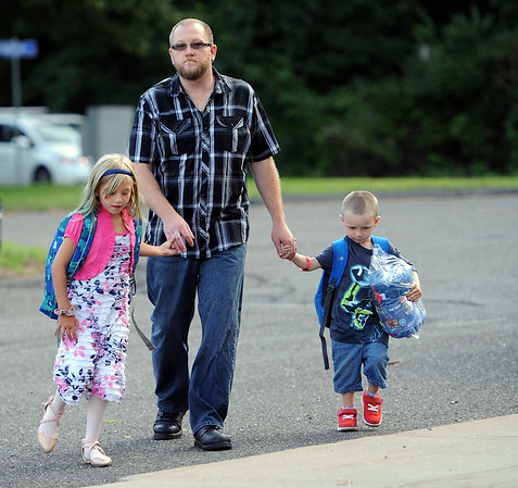 8/28/2019 Mike Orazzi | Staff Tim Roberts with his children Faith and Remi on the first day back to school at the Plymouth Center School on Wednesday morning.