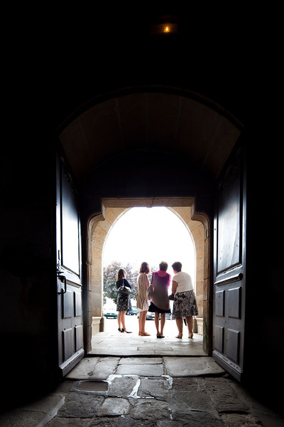 Women at the door of Saint-Guigner church, town of Pluvigner, departement of Morbihan, Brittany, France